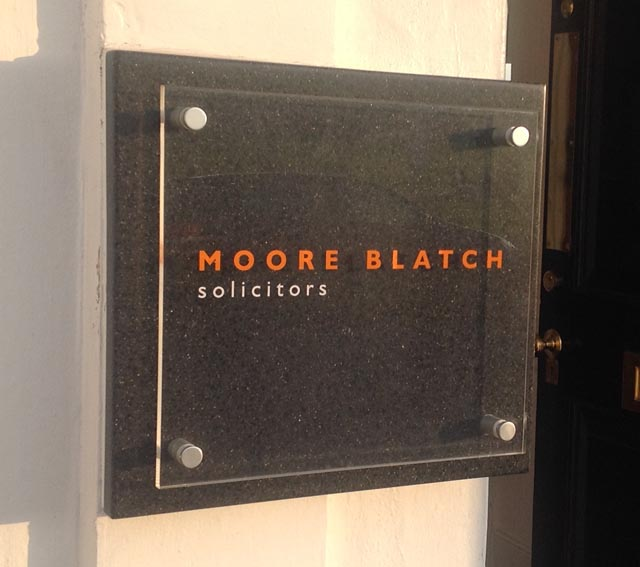 sign outside Moore Blatch solicitors in Richmond