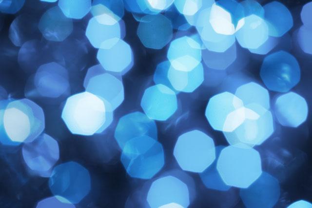 Hexagons of blue light, as seen through a lens.
