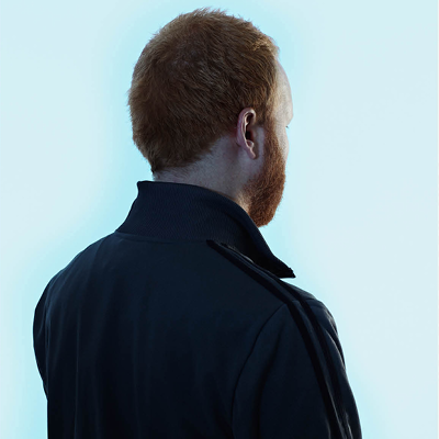 back of a man, featured in a campaign poster