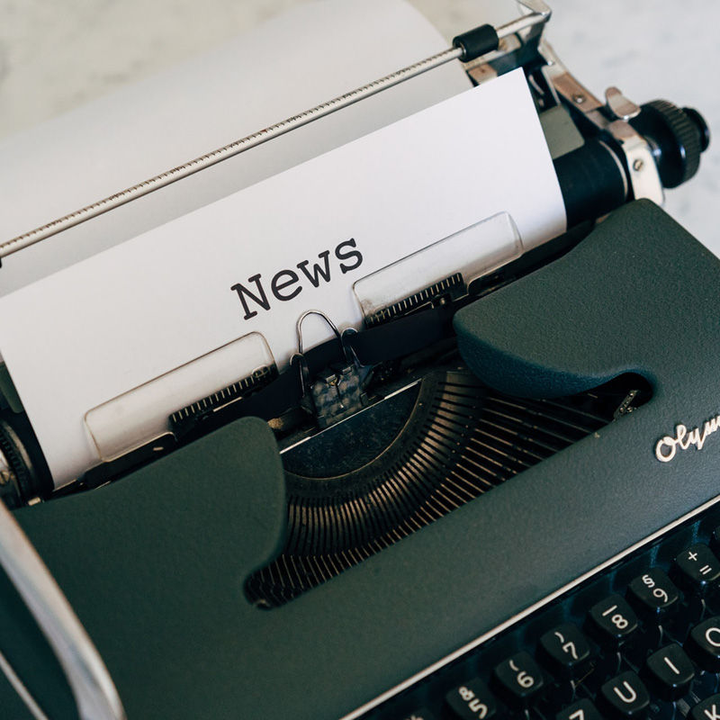 Press release typed on an old-fashioned typewriter.